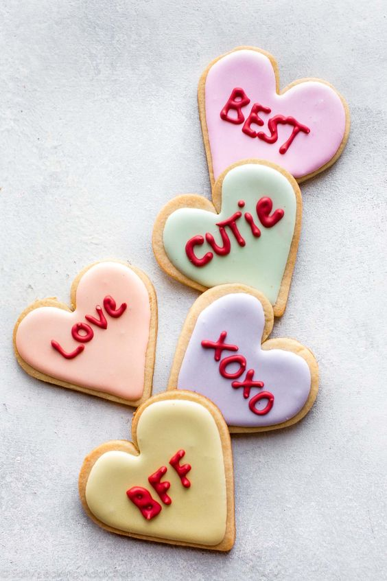 Cute valentine's day cookies and heart shaped cookies with customized words