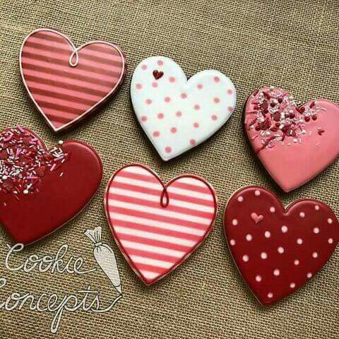 Red valentine's day cookies and heart shaped cookies