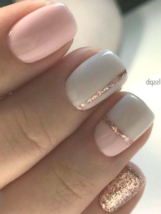 Simple spring nails with pink, white and gold glitter on short nails