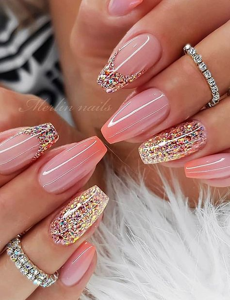 Pink acrylic spring nails with glitter