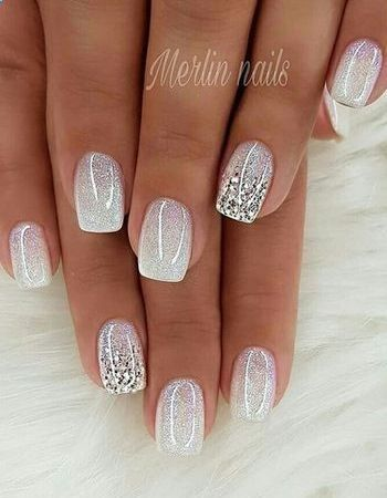 Short white nails with glitter by Merlin Nails