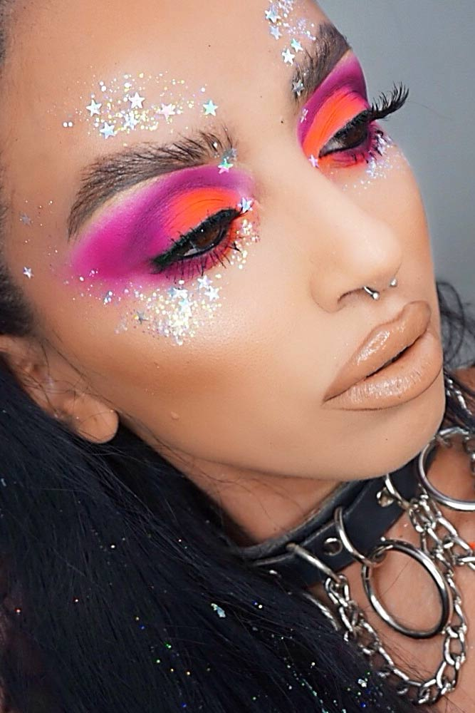 Cute festival makeup ideas with simple festival face gems and pink bold eyeshadow