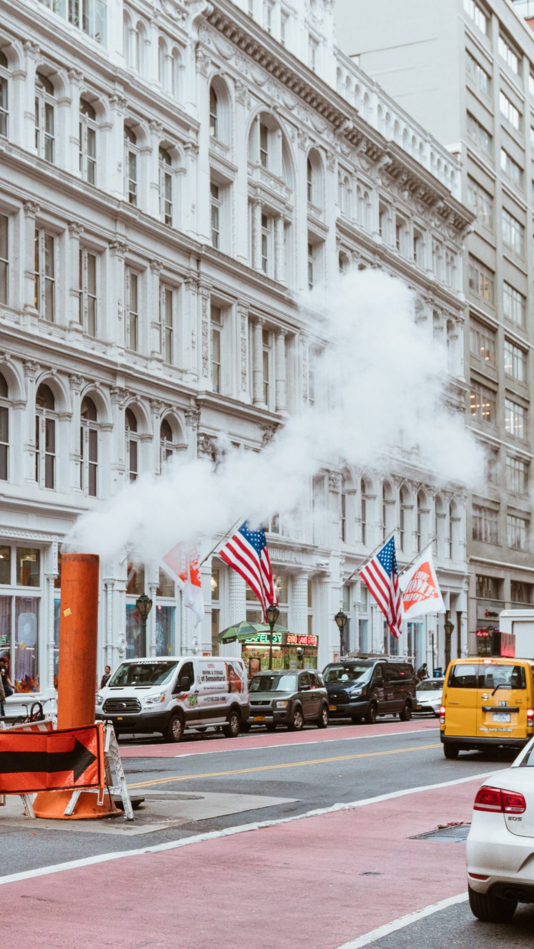 Beautiful New York City architecture with American flags