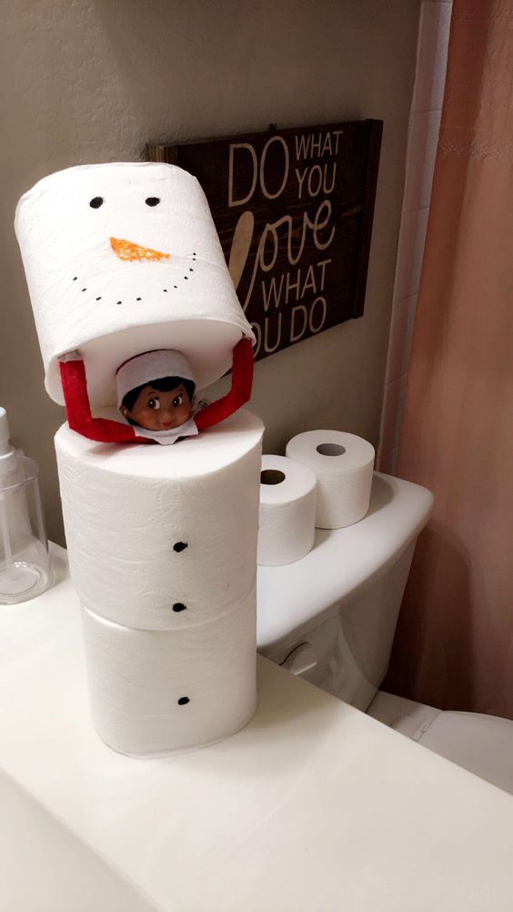 Funny elf on the shelf ideas in the bathroom with toilet paper