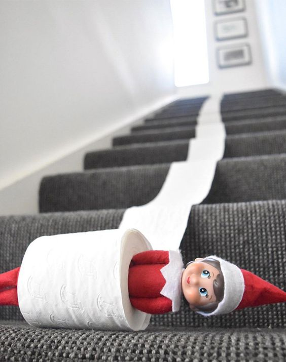Naughty elf on the shelf ideas with toilet paper on stairs