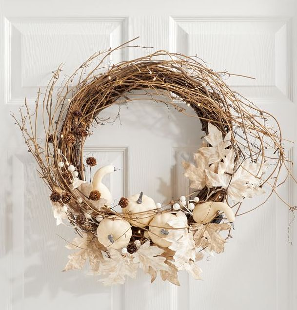 Fall wreath with white pumpkins and leaves