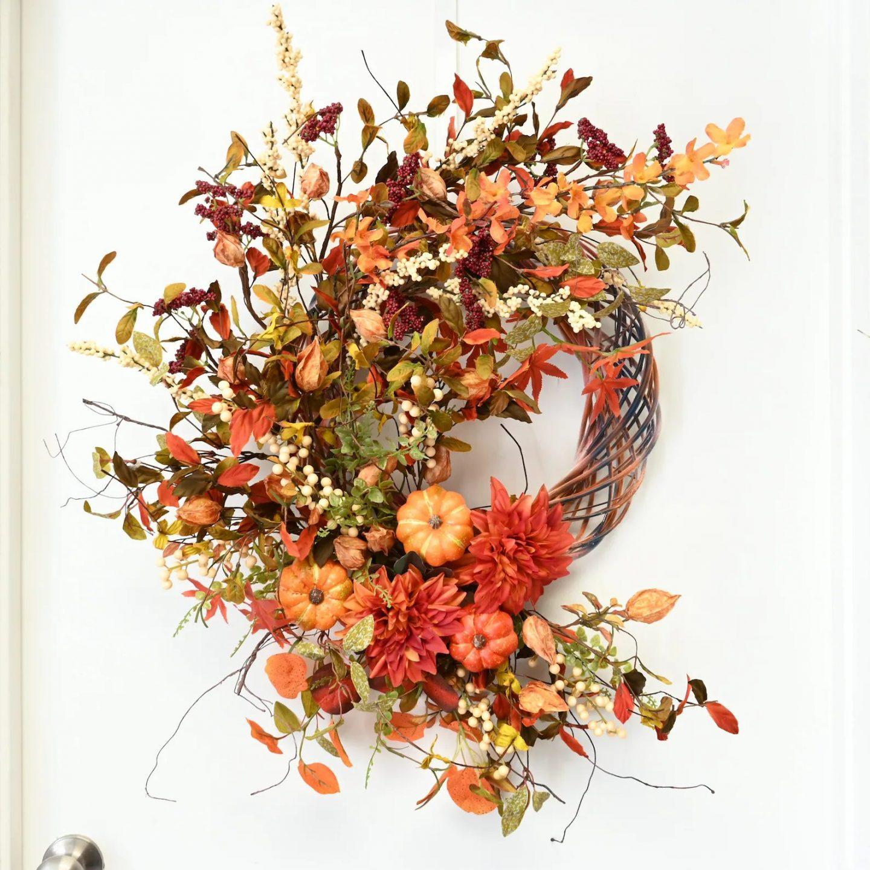 Orange rustic fall wreath with pumpkins
