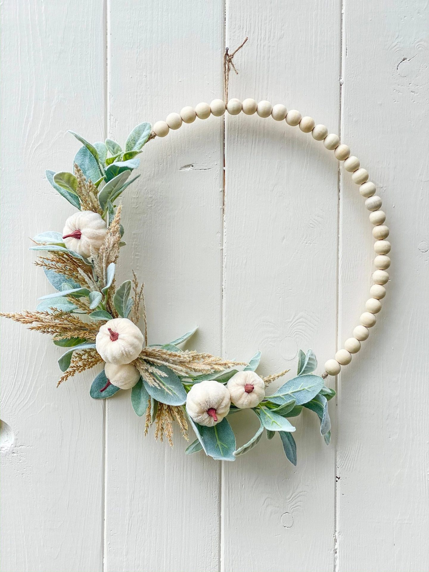 White beaded hoop wreath with pumpkins