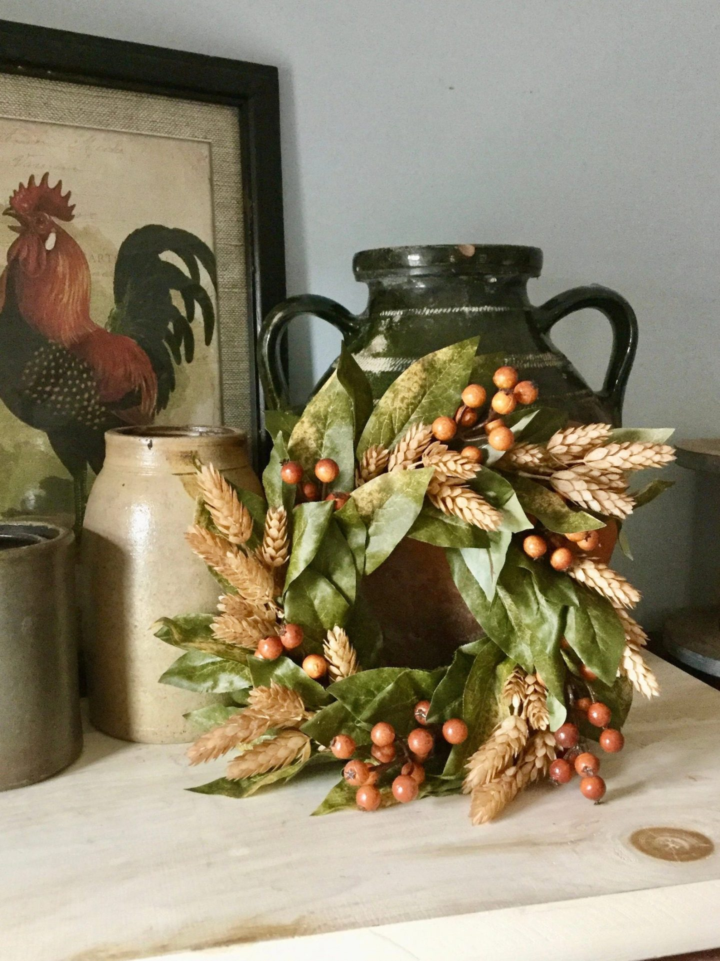 Cute rustic candle wreath with wheat and magnolia