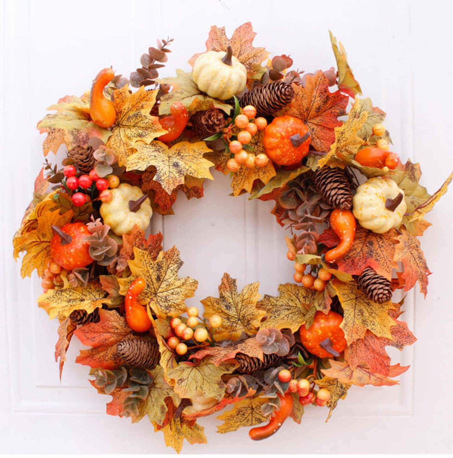 Fall wreath with leaves and pumpkins