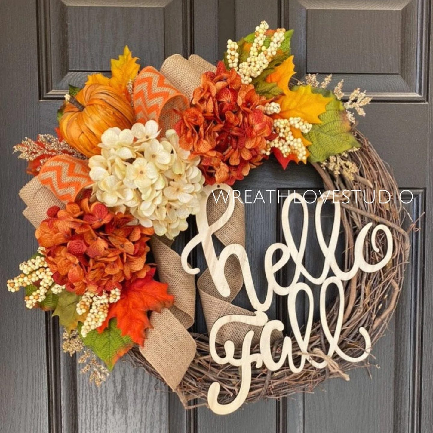 Hello Fall grapevine wreath with leaves, flowers and pumpkins