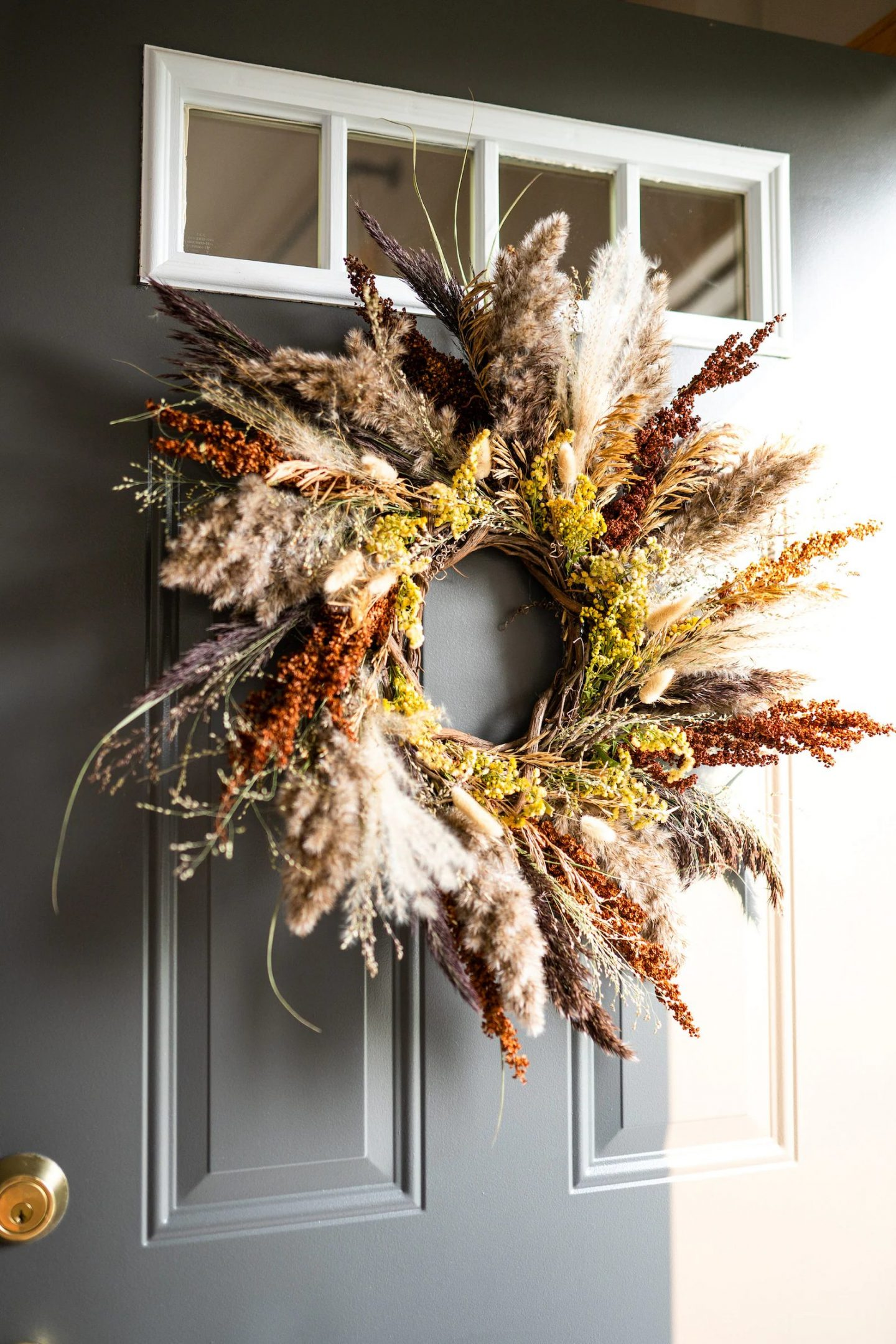 Autumn wreath with dried flowers and pampas grass