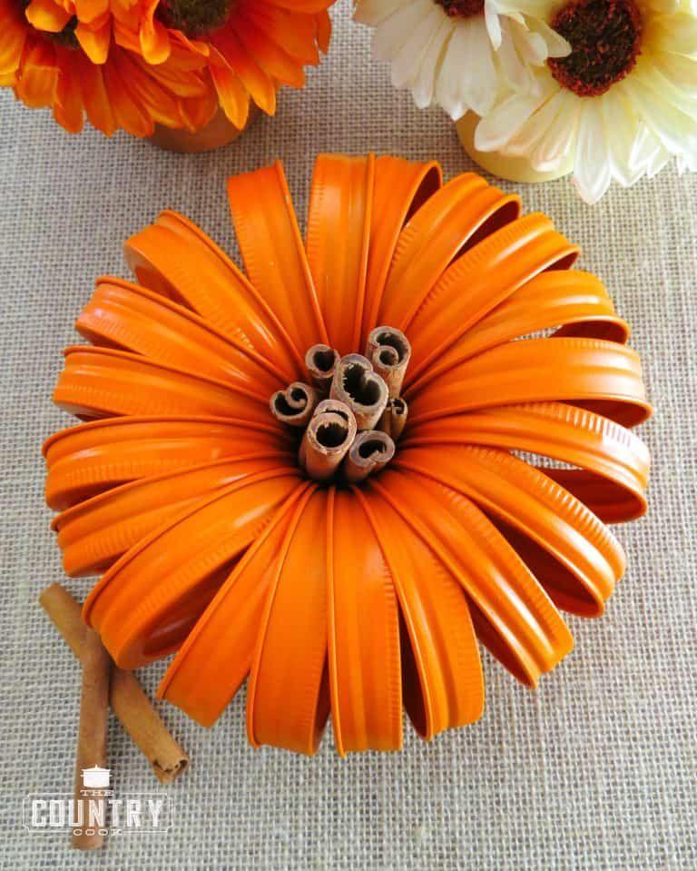 Easy fall crafts for adults: Mason Jar Lid Pumpkin