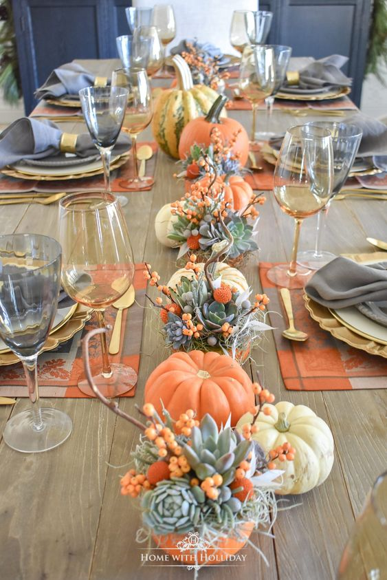Simple and elegant Thanksgiving table settings with pumpkins