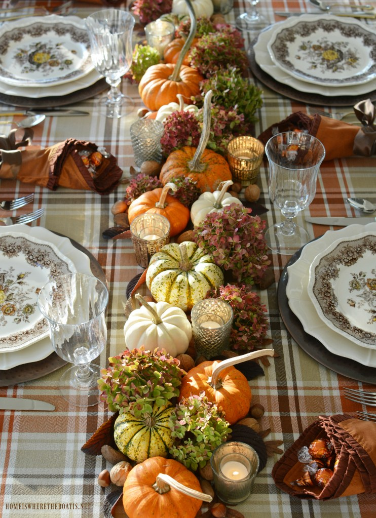Rustic table setting with pumpkins