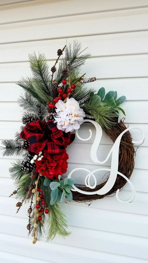 Rustic monogram wreath with red ribbon and branches