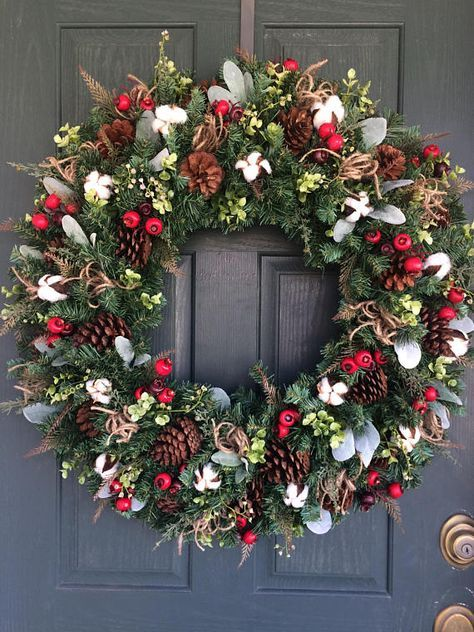 Rustic wreath with red berries and pinecones