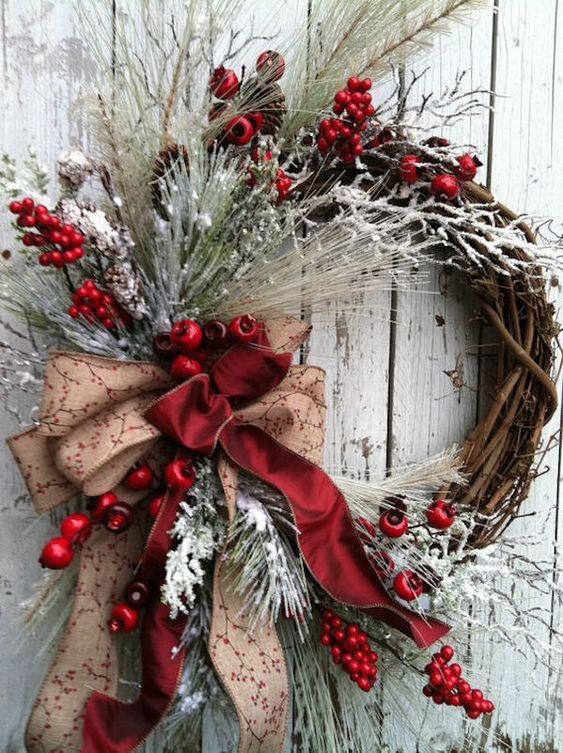 Rustic white wreath with red accents, red berries and red ribbon