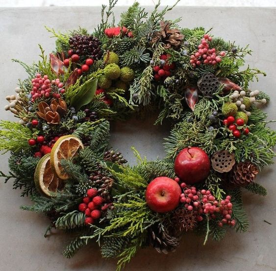 Rustic wreath with oranges, cranberries and apples