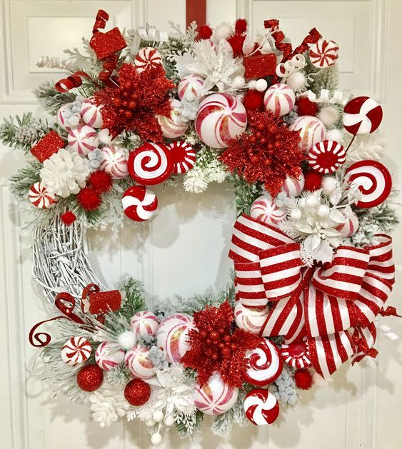 Red and white Christmas wreath with peppermint and ribbons