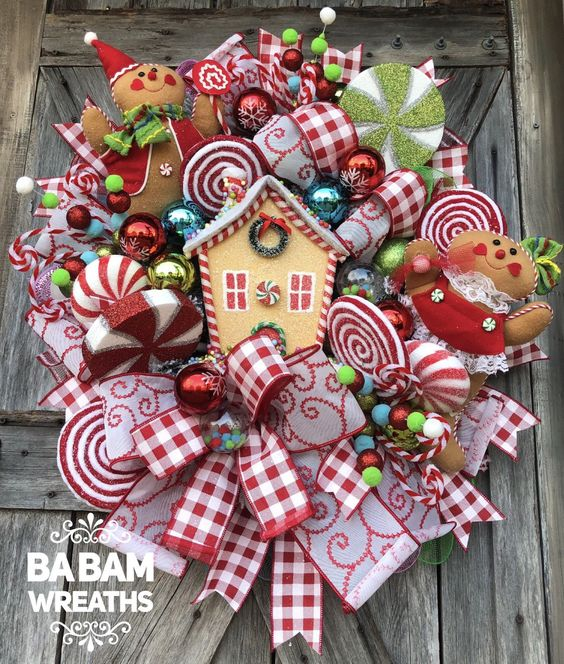 Red gingerbread man Christmas wreath with ribbons