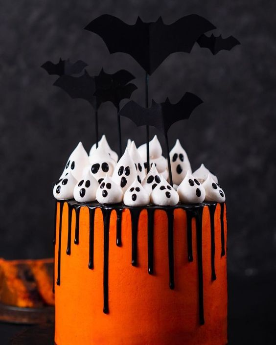 Spooky orange halloween cake with ghosts