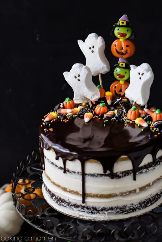 Pumpkin chocolate Halloween cake with ghost cake toppers