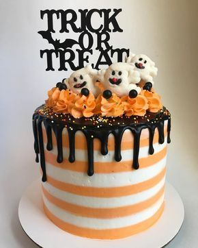 White And Orange halloween cake with toppers