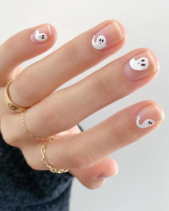 Cute Halloween nail art with ghosts, ghost nail art