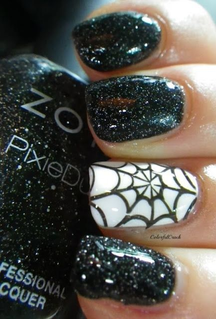Black and white Halloween nails with spiderweb