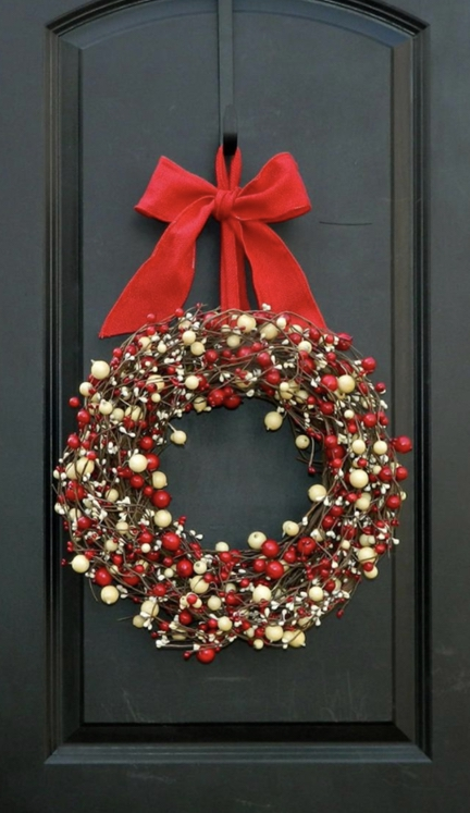 Holiday wreath with red ribbons
