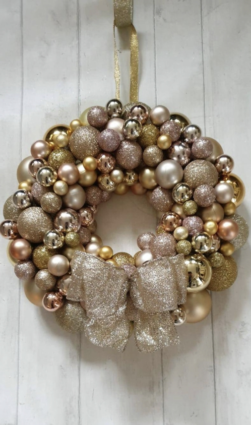 Gold bauble wreath with ribbon