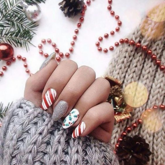 Cute candy cane nails with mistletoe and silver glitter