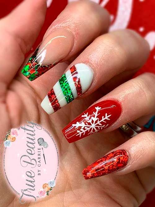 White, green and red holiday nail designs with snowflakes on acrylic coffin nails