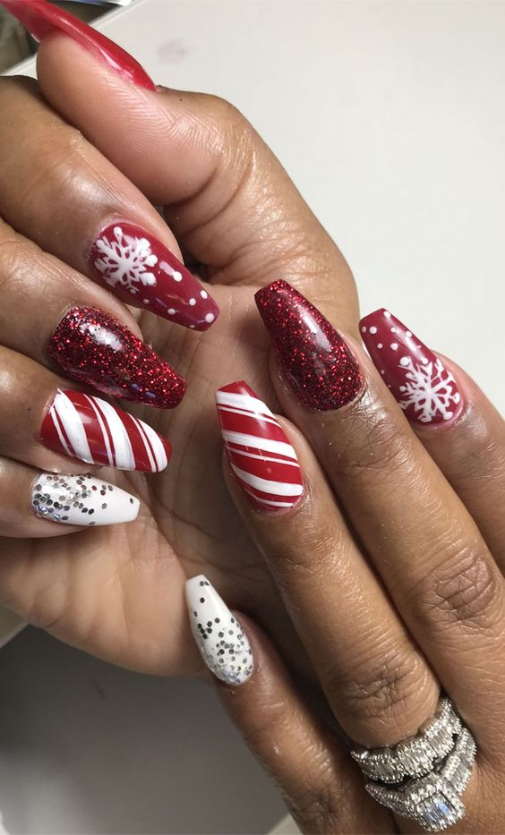 Red and white Christmas nail designs with candy cane nails and snowflake nails