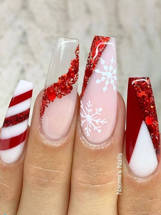 Red, white and pink Christmas nail designs on coffin acrylic nails with snowflakes