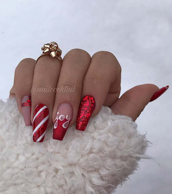 Red Christmas nails with white candy cane stripes - acrylic coffin nails