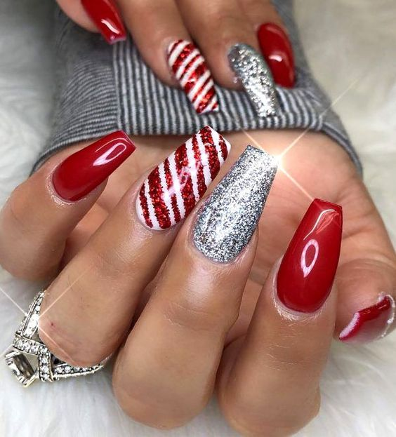 Silver glitter and red Christmas nails with candy cane stripes