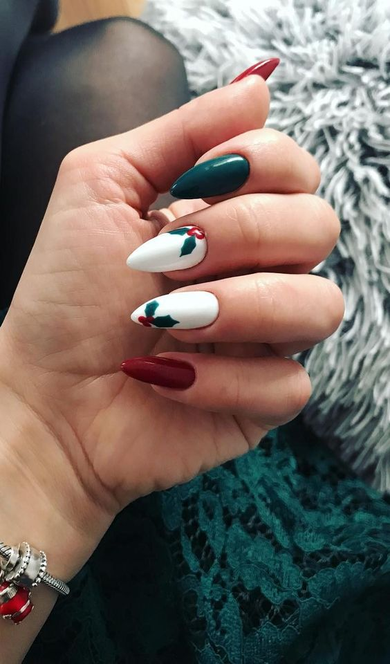 Almond shaped acrylic green, red and white Christmas nail designs with mistletoe