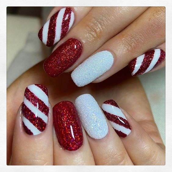 Red and white candy cane nails with glitter
