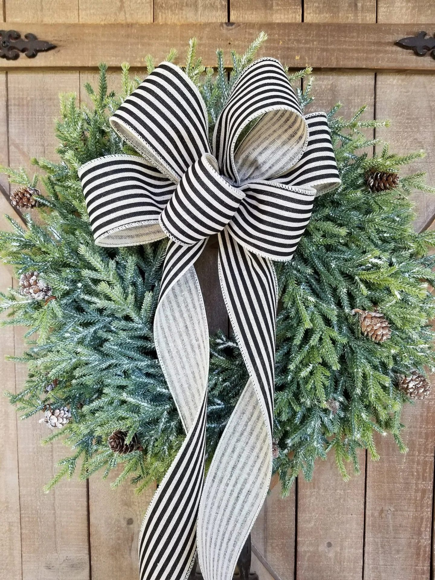 Simple Christmas wreath with black and white ribbon