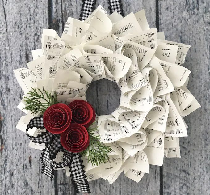 Cute Christmas wreath with musical note paper, roses and buffalo plaid