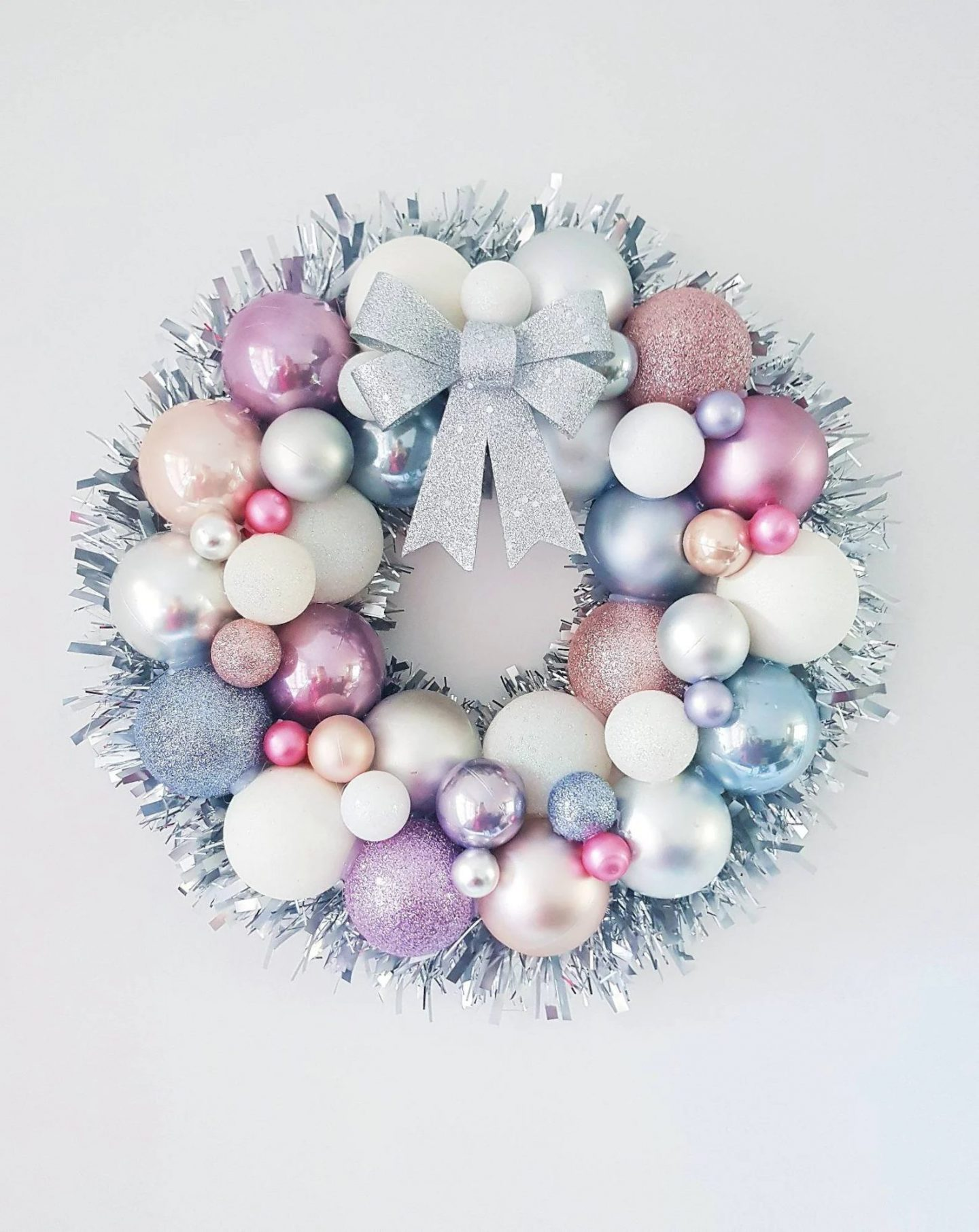 Elegant white and silver bauble wreath for the holidays