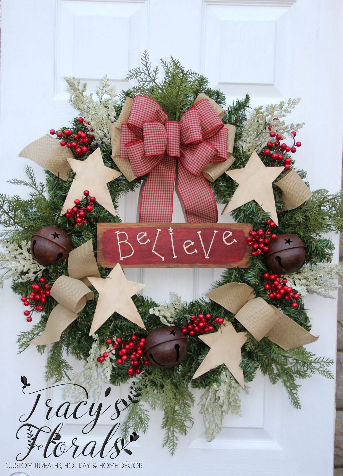 Rustic Christmas wreath with stars and red ribbon