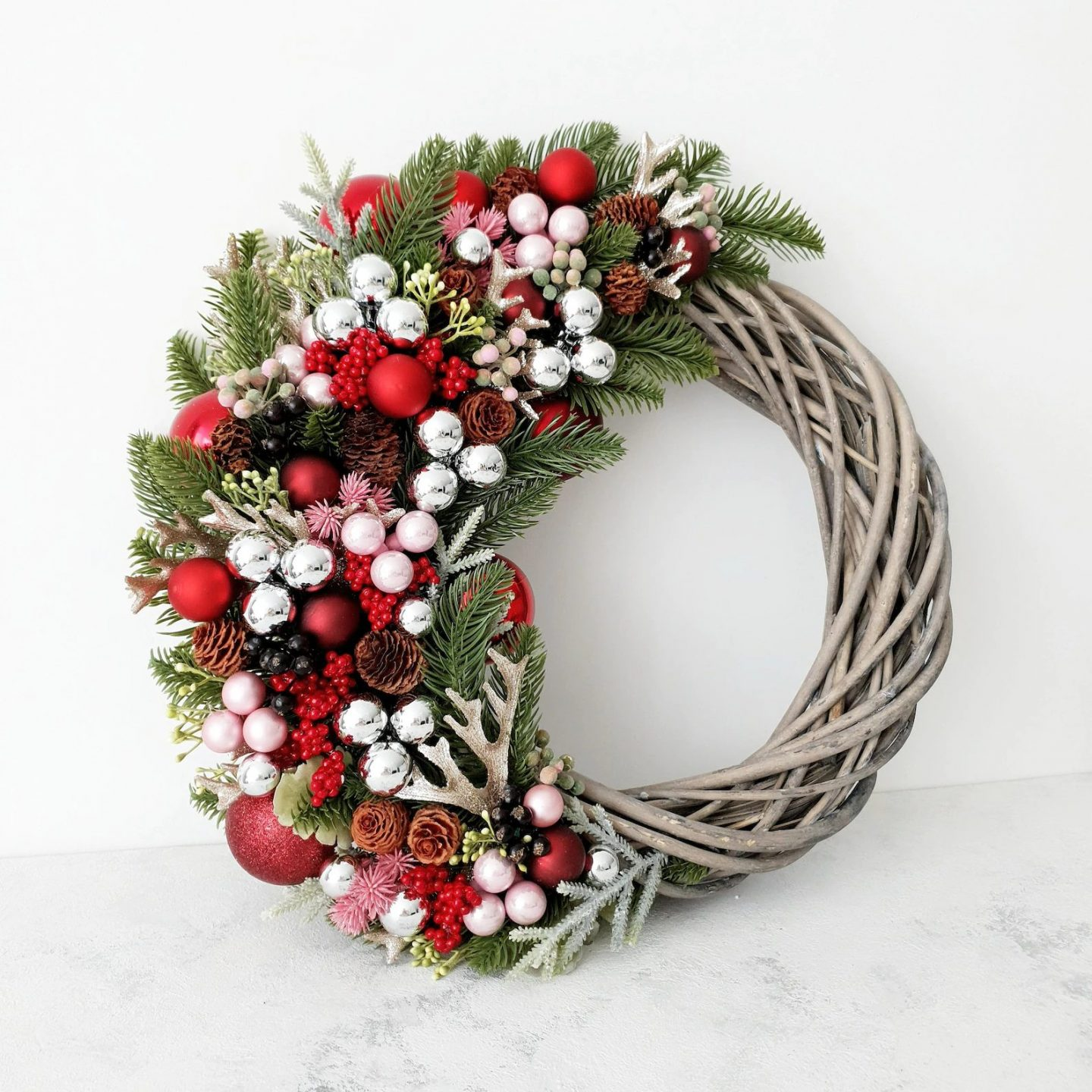 Elegant Christmas wreath with small red and silver baubles