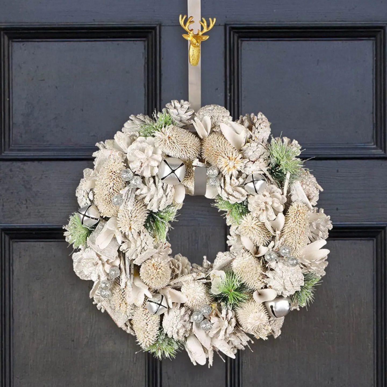 Elegant white Christmas wreath with pinecones