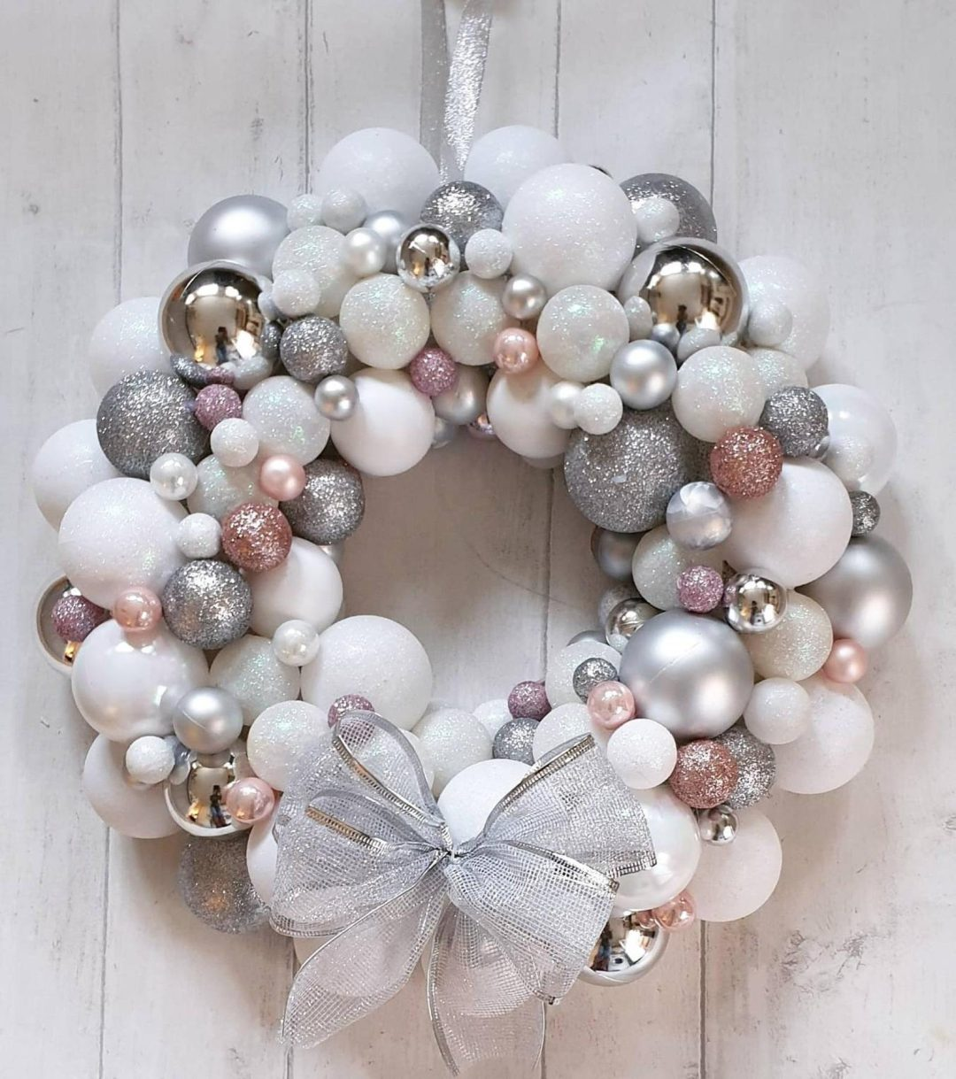 White and silver bauble wreath with ribbon