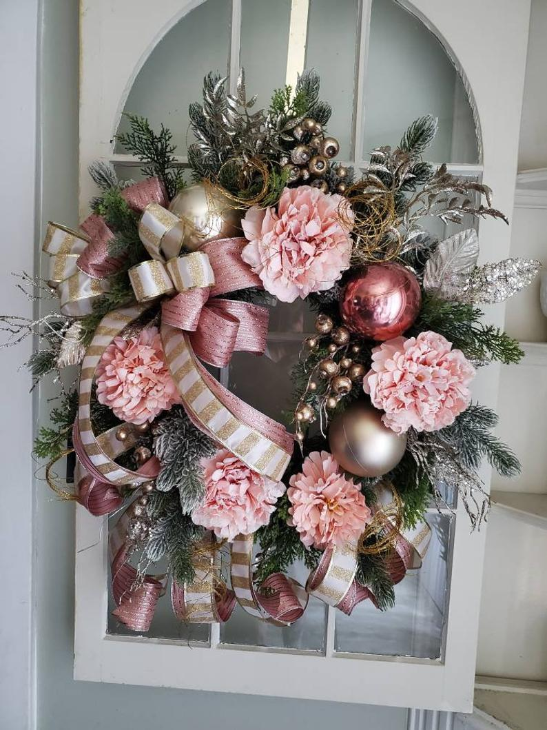 Elegant pink and rose gold Christmas wreath with peonies and flowers