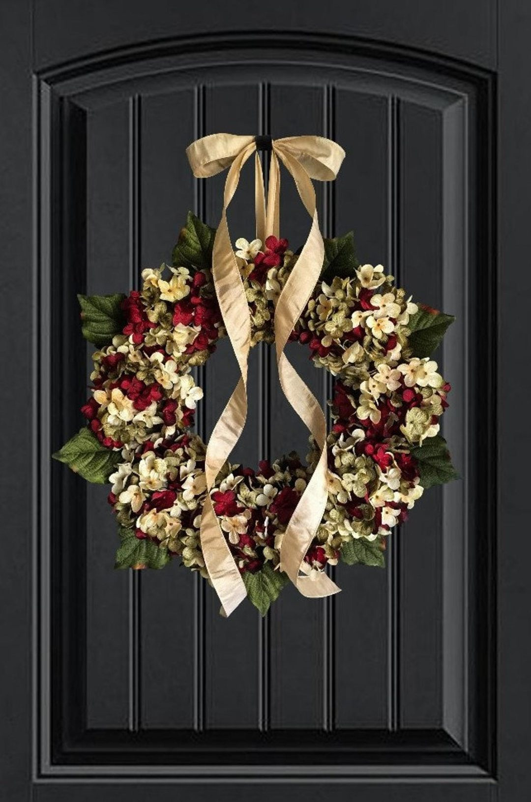 Red and gold flower wreath with gold ribbon for the holidays