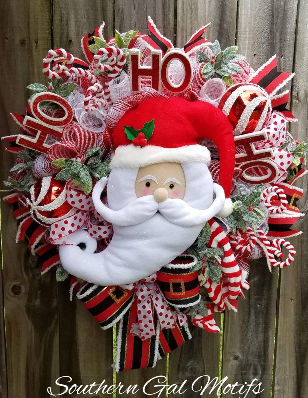 Red Santa Claus wreath with candy canes
